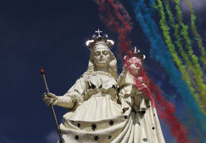 Fireworks are seen at the inauguration of the statue of the Virgin of the Socavon, the patron saint of miners, at Santa Barbara hill on the outskirts of Oruro
